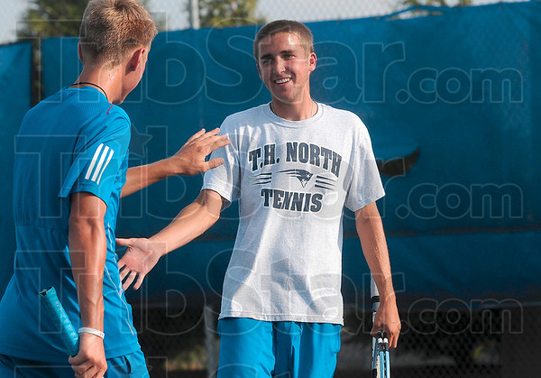Tribune-Star/Joseph C. Garza<br /> Way to go, No. 2 dubs: Terre Haute North No. 2 doubles player Justin Huxford, right, congratulates teammate Grant Potts after they won a point against their Northview opponents Thursday at North.