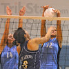 Point arrows: Sullivan's Jackie Bezy (8) spikes the ball through the block of Lakers Lacy Ashcraft and Mikayla Crane.