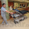On the move: Union Hospital transporter Kevin Hoggatt wheels a bed through a nurses station Tuesday.