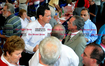 8/31/2010 Mike Orazzi | Staff Dan Malloy talks with State Rep. Frank Nicastro while at the Crocodile Club at Lake Compounce on Tuesday afternoon.