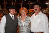 (Denver, Colorado, Sept. 9, 2010)<br /> Jay Lombardi (general manager of Hideaway Steakhouse in Westminster, targeting an opening in January, 2011) with Terrie and Steve Woodward (owners).  The 2010 Hide Party, recognizing the winning bidders of the 2010 Auction of Junior Livestock Champions, at the National Western Stadium Arena in Denver, Colorado, on Thursday, Sept. 9, 2010.<br /> STEVE PETERSON