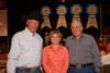 (Denver, Colorado, Sept. 9, 2010)<br /> George Eidsness, Lisa Meireis (CoBiz Financial), and Randy Pennington.  The 2010 Hide Party, recognizing the winning bidders of the 2010 Auction of Junior Livestock Champions, at the National Western Stadium Arena in Denver, Colorado, on Thursday, Sept. 9, 2010.<br /> STEVE PETERSON