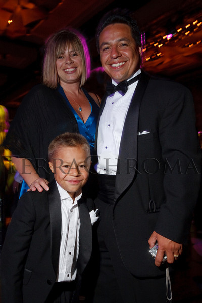 """(Denver, Colorado, Sept. 11, 2010)<br /> Christian Moreno with his parents, Stacy and Abel.  The Children's Hospital hosts """"Gala 2010--What Matters Most"""" at the Hyatt Regency Denver at the Colorado Convention Center in Denver, Colorado, on Saturday, Sept. 11, 2010.<br /> STEVE PETERSON"""