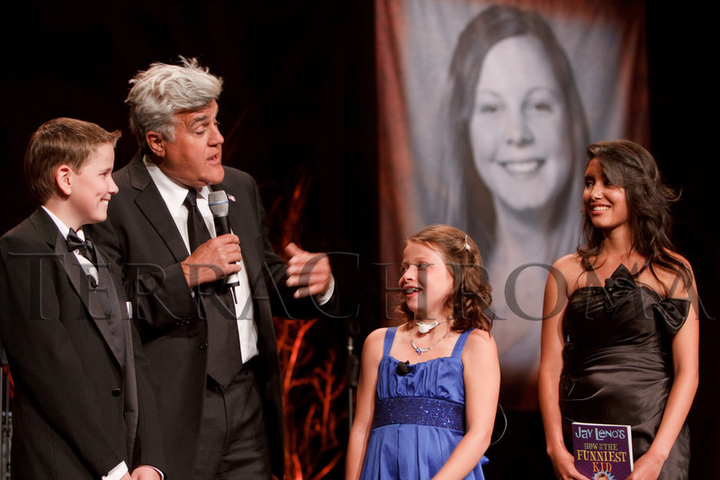 "(Denver, Colorado, Sept. 11, 2010)<br /> Jay Leno (second from left) interviews some of The Children's Hospital ambassadors, including Kohl Benjamin (left), Hannah Kropp, and Amber Roybal.  The Children's Hospital hosts ""Gala 2010--What Matters Most"" at the Hyatt Regency Denver at the Colorado Convention Center in Denver, Colorado, on Saturday, Sept. 11, 2010.<br /> STEVE PETERSON"