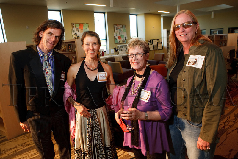 "(Thornton, Colorado, Sept. 11, 2010)<br /> Howard Steele, Katy Charles, Mary Thelen, and artist DiAnne Cooper.  ""Sparkopolis,"" a benefit hosted by the Rangeview Library Friends Foundation, supporting the Rangeview Library District's collaborative public art project, ""This is Who We Are,"" at Anythink Wright Farms library in Thornton, Colorado, on Saturday, Sept. 11, 2010.<br /> STEVE PETERSON"