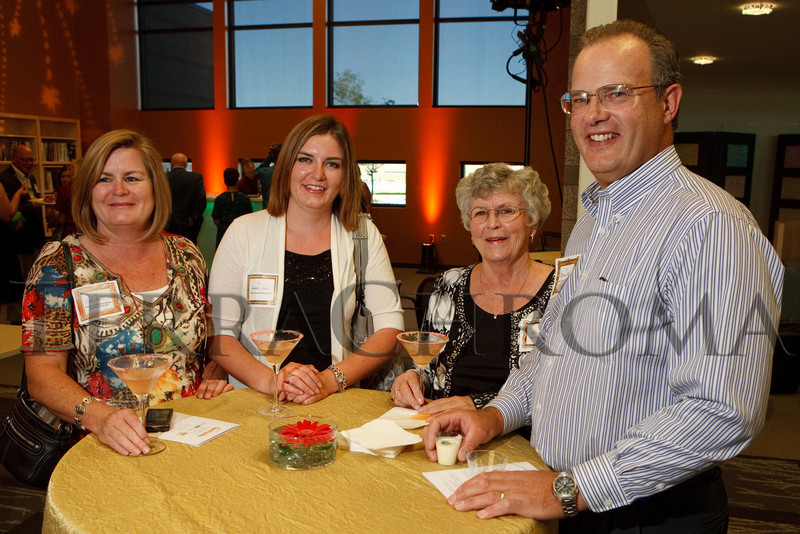"(Thornton, Colorado, Sept. 11, 2010)<br /> Sue and Lexie Hall, Nancy Brooks, and Brian Hall (RLFF board of directors secretary).  ""Sparkopolis,"" a benefit hosted by the Rangeview Library Friends Foundation, supporting the Rangeview Library District's collaborative public art project, ""This is Who We Are,"" at Anythink Wright Farms library in Thornton, Colorado, on Saturday, Sept. 11, 2010.<br /> STEVE PETERSON"