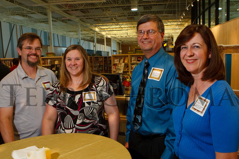"(Thornton, Colorado, Sept. 11, 2010)<br /> Karl and Tiffiny (cq) Peterson (won tickets to the event via Anythink on Facebook) alongside Pete and Debbie Finnie.  ""Sparkopolis,"" a benefit hosted by the Rangeview Library Friends Foundation, supporting the Rangeview Library District's collaborative public art project, ""This is Who We Are,"" at Anythink Wright Farms library in Thornton, Colorado, on Saturday, Sept. 11, 2010.<br /> STEVE PETERSON"