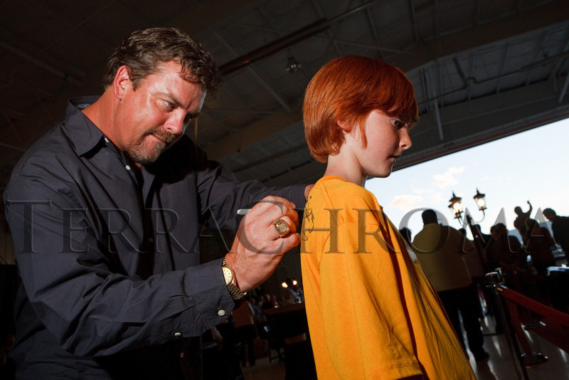 "(Broomfield, Colorado, Sept. 23, 2010)<br /> Sean Fister signs ten-year-old Brad Howell's shirt.  The ""5th Annual Dinner Royale,"" benefiting Greenhouse Scholars, at the Omni Interlocken Hotel and Rocky Mountain Metropolitan Airport in Broomfield, Colorado, on Thursday, Sept. 23, 2010.<br /> STEVE PETERSON"