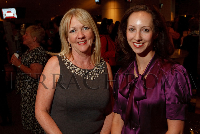 "(Denver, Colorado, Sept. 27, 2010)<br /> Lisa Bailey (director of marketing, Four Seasons Denver and Four Seasons Resort - Vail) with Dana Berry.  ""Behind the Curtain,"" a benefit for the expansion of the Anschutz Cancer Pavilion, hosted by the University of Colorado Hospital Foundation, at Invesco Field at Mile High in Denver, Colorado, on Monday, Sept. 27, 2010.<br /> STEVE PETERSON"