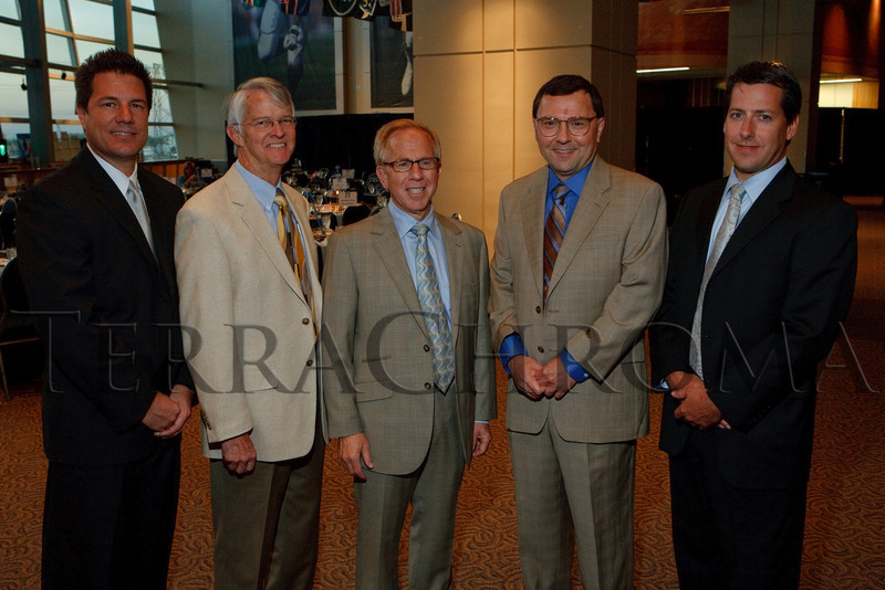 "(Denver, Colorado, Sept. 27, 2010)<br /> Chris Comer, Strode Weaver, Bruce Schroffel (UCH president and CEO), Dr. Dan Theodorescu (University of Colorado Cancer Center director), and Brad Fixler .  ""Behind the Curtain,"" a benefit for the expansion of the Anschutz Cancer Pavilion, hosted by the University of Colorado Hospital Foundation, at Invesco Field at Mile High in Denver, Colorado, on Monday, Sept. 27, 2010.<br /> STEVE PETERSON"