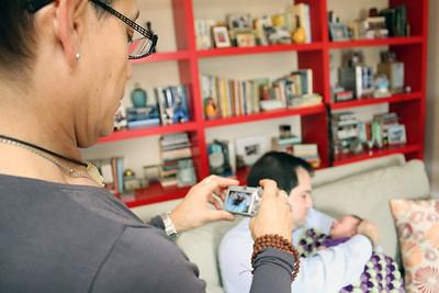 Uncle Jordan photographs Great Aunt Jamie photographing Uncle Craig holding Shai