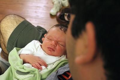 Uncle Jordan holds Shai
