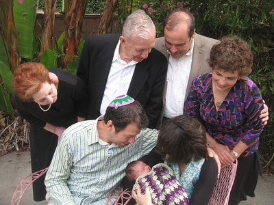 Bubbe Pat, Grandpa Wallace, Grandpa Gary, and Grandma Hope, with children and granddaughter