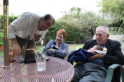 Uncle David sets up Skype between his family and Bubbe Pat and Grandpa Wallace (photo by Jordan Fifer)