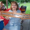 Shannon and the sign grandpa made her for her birthday. Party at Kensington Metropark.