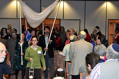 The new Torah is taken on a processional through the congregation, featuring seven teams of honorees escorting it with lanterns and a traditional wedding chuppah (photo by Sam Backman)