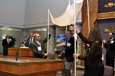 The new Torah scroll begins on a processional through the congregation, featuring seven teams of honorees escorting it with lanterns and a traditional wedding chuppah (photo by Sam Backman)