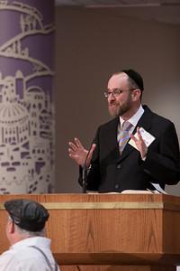 Sofer (Torah scribe) and Rabbi Menachem Youlus gives opening remarks