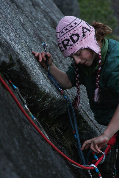 Jenni works her way up <i>Snowflake 5.8</i> in the dim light of an Alaskan summer midnight.