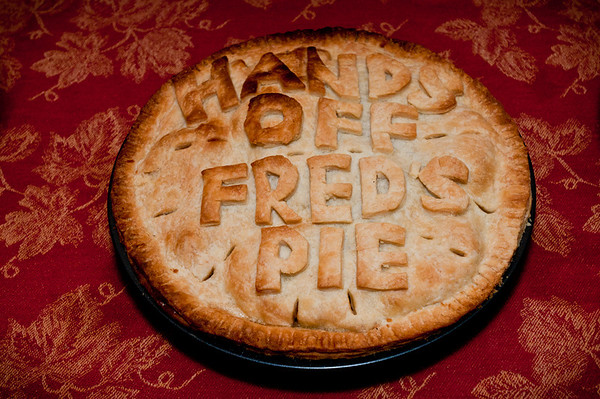 Ever since my great-Uncle got into the restaurant business (and helped create the likes of The Rainbow Room, Windows on the World, and many others) my family always throws some pretty yummy Thanksgiving feasts. Every year one of my other Uncles bakes a pie. Knowing my grandfather loves Apple/Pear pies he baked one specifically for my grandfather. I present to you: Fred's Pie!   Nikon D300s w/Nikkor 17-35mm f/2.8 ED-IF AF-S: 35mm, f/5.6, 1/60 sec, ISO 400, SB-800 Flash w/Gary Fong Diffuser