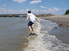 Benjamin jumping over the surf