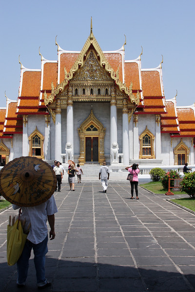 Visitors peruse one of Bangkok's many tourist attractions.