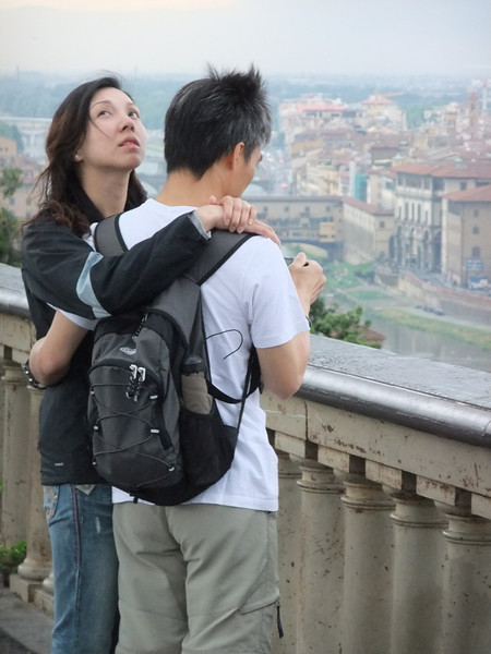 Unidentified couple at Piazzale Michelangelo in Firenze just before we -- and they --  sought refuge from  a thundershower that fast was approaching.