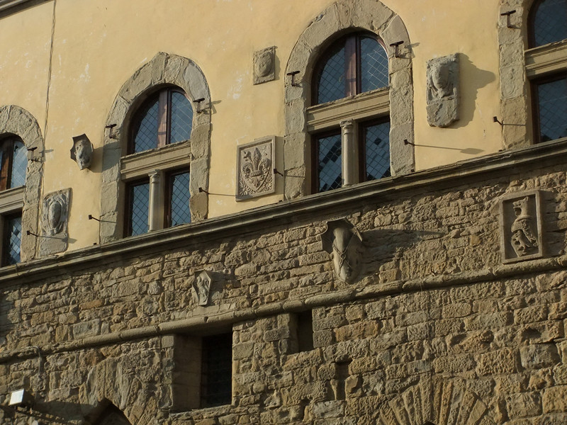 Arezzo:  bas relief on the biblioteca at the corner of Corso Italia and Via degli Albergotti.  Geographic coordinates:  43.465483,11.88345.