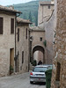 Morning rush hour in Spello:  pedestrians crowd Via Fontevecchia; camera is looking southward down the street toward Porta Fontevecchia.