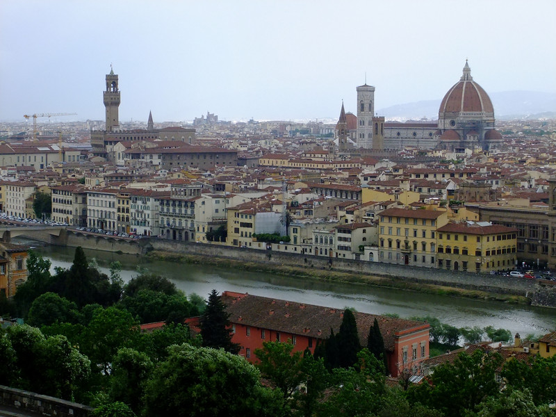 (from left) construction crane, Palazzo Vecchio, and Duomo in Firenze as seen from Piazzale Michelangelo; a thundershower washes out the hills that normally form a backdrop to the city.