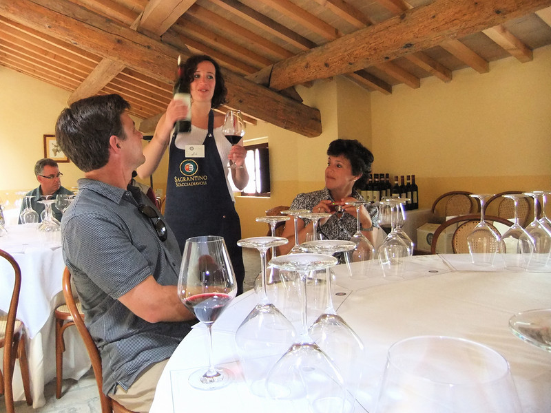 The woman in the center is Liù, an employee of Scacciadiavoli, a winery that makes Sagrantino di Montefalco and Montefalco Rosso, here conducting a vertical wine tasting of Montefalco Rosso at the winery.  Liù married into the Pambuffeti family, owners of Scacciadiavoli, and served an apprenticeship in winemaking in Bordeaux.  She is pouring for the pastor and his wife of a Presbyterian church in Solana Beach, California.