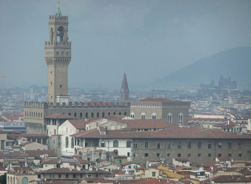 Palazzo Vecchio at Piazza della Signoria in Firenze as seen from Piazzale Michelangelo; an intense thundershower is drenching the northwestern portions of the city in the background.