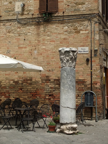 Outdoor café tables at north end of Piazza Silvestru, Bevagna, Umbria.