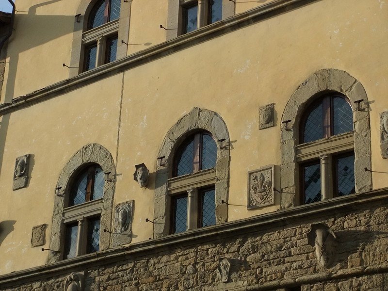Arezzo:  bas relief on the biblioteca at the corner of Corso Italia and Via degli Albergotti.