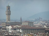 The building with a tower is Palazzo Vecchio on Piazza della Signoria in Firenze; this view is from Piazzale Michelangelo as a thundershower is beginning to envelope the city.