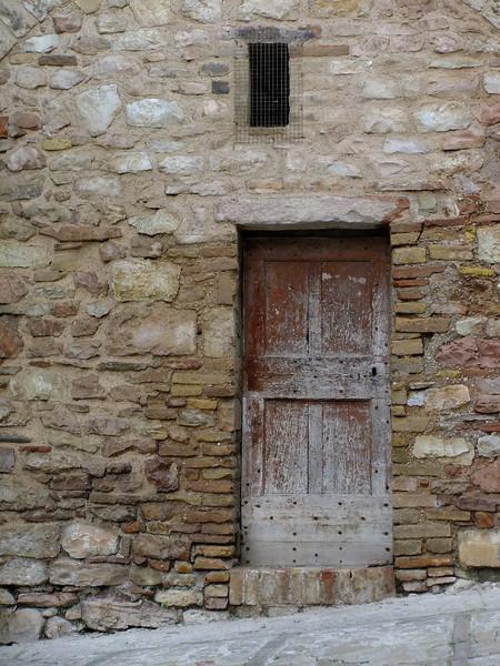 """Upper end of Via Fontevecchia, Spello, Umbria; camera set to """"Velvia"""" fim simulation."""