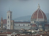 The Duomo of Firenze as viewed from Piazzale Michelangelo; a thundershower is drenching the hills and the northern part of the city in the background.