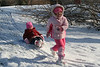 Jenna pulls her sister on the sled