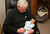 Poppop holds his baby grandson