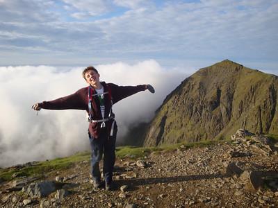 Andrew T strikes his signature pose atop Carnedd Ugain summit
