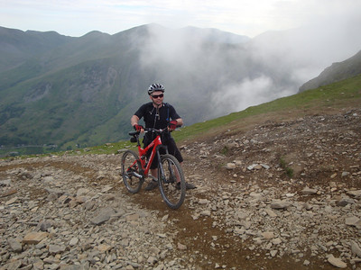 Our long descent to Nant Peris's valley was briefly lightened by the appearance of this Welsh cyclist, pushing his bike to the top of Mt Snowdon. It was wonderful to feel briefly sane.