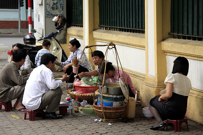A very typical setup for dining on the streets in Vietnam, practiced by nearly everyone.