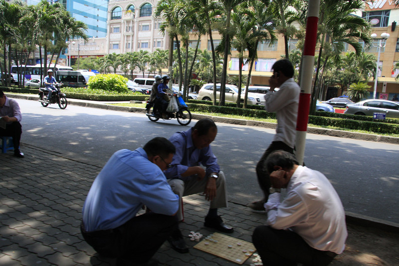 Playing checkers on the street in Saigon