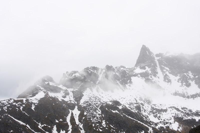 Pinnacle Peak takes on a light dusting of summer snow.
