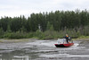 Tom King drives the airboat out of a small side channel with barely a trickle of water flowing through, demonstrating the amazing versatility of such a large apparatus.