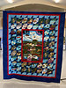 "The Last Frontier was the pattern used by  Mary Throndson for ""Alaska Memories"" It  will be a lasting memory of an Alaska  adventure.  Made in 2020 it is a 78"" x 92""  blue quilt showing scenes from Alaska.  Gerry  McGuire quilted it adding 50 stars on the  boarders."