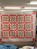 Grandma's Quilt is a pink, green and white  double bed size.  Barbara Reineke's  grandmother, Sara Jane (Eva) Bissell Jones  made this quilt in the 1930's and the AGUMW  quilted it in 2000.