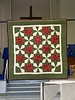 "This red and green Stack 'n Whack is called  Christmas Stars made and quilted by Sandy  Underwood in 2012.  It's a 39"" square"
