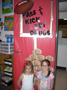 Second grade teachers and students got in the spiirit of of Red Ribbon Week by decorating their doors to stress a drug free world and having good character.