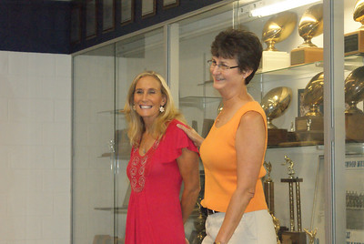 Windsong teacher Shana Appel was hnored for her basketball, volleyball and track skills at FHS.  FHS alumna Glenda McDonald presented Shana with her awards.